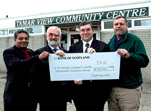 Presentation of the cheque for £100K  by the SWRDA